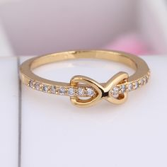 Unique Bowknot Design 18K Gold Plated Fashion Copper Finger Ring Inlay Zircon Three Sizes
