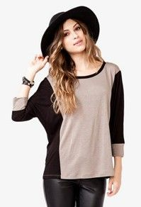A wide-brimmed hat instantly creates a bohemian look. Perfect for enjoying a day walking around Austin!