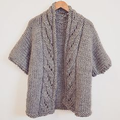 Super Bulky Drops Polaris Cardigan. We love the short sleeves and cables in this…