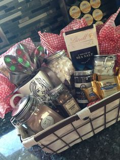 One pinner wrote :Gift basket I made for Joe, hot chocolate, marshmallows, cinnamon sticks, sprinkles, chocolate, chocolate spoons, mug that I drew Ginger spice on ( he loves her ) mason cup and cute vintage basket all for a little under $40