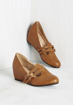 Suits You to a Teach Wedge in Cognac. Its not just your lectures that are so impressive, but also how perfectly these cognac wedges complement your scholarly looks! #tan #modcloth