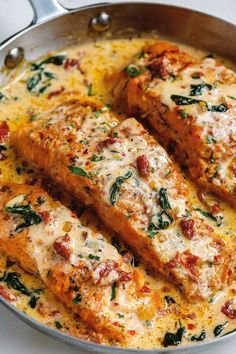- Smothered in a luscious garlic butter spinach and sun-dried tomato cream sauce, this Tuscan salmon recipe is so easy, quick, and simple. - by Creamy Garlic Tuscan Salmon With Spinach and Sun-Dried Tomatoes - Fish Dishes, Seafood Dishes, Seafood Recipes, Chicken Recipes, Cooking Recipes, Healthy Recipes, Healthy Food, Keto Recipes, Cooking Pasta