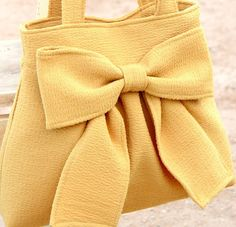 Mustard Bow Bag / Purse w/ Double HandleI keep pinning things I love from etsy.Just the photo, but I love the color, the style, and that bow on the front is utterly adorable. I would totally rock this! Bow Bag, Bow Purse, Pretty Outfits, Cool Outfits, Pink Tote Bags, Recycle Jeans, Everyday Bag, Cute Bags, Mellow Yellow