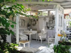 Outdoor Room ~ Walls made from salvaged materials to create a cozy room within a larger space - (via shabbylandhaus)