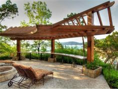 Waterfront pergola with firepit