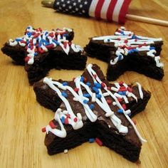 4th of July Brownies. Bake a large tray of brownies, use a star cookie cutter for the pattern & add colored frosting. Perfect!