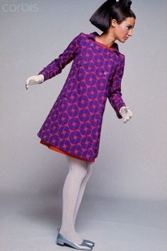 Patterned Ungaro Coat: Model wearing a pumpkin and Parma violet coat with a geometric print, and matching dress beneath, by Ungaro, paired with ribbed white stockings; and silver flats. 60s And 70s Fashion, Mod Fashion, Fashion Show, Vintage Fashion, Vintage Dresses, Vintage Outfits, Purple Coat, Purple Haze, Fashion History