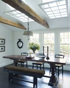 love the bench at the dining table