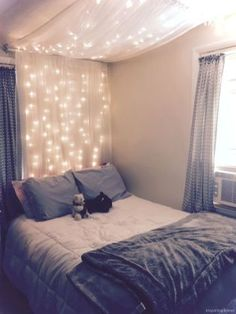 Abigail's Room DIY light canopy: Materials: 63 inch 2 panel sheer curtains 2 garden hooks 1 curtain rod (round cylinder) 2 curtain rods that anchor into wall Fairy string lights