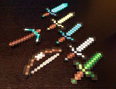 "Minecraft Diamond Sword made with Perler by CreativeKidShoppe - these are larger - like 8"" - $10 each (etsy)"