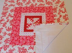 This little quilt features some of my favorite things - polka dots, gingham, cherries, flowers and love birds in red, pink and white. It will make a great addition to your Valentines Day decor or any time of year to add a pop of color to your room. The double fold binding is machine stitched on and then hand stitched to the backing, which is a white tonal leaf print.  Machine quilted. Quilt measures 17 by 17. Machine wash gentle, warm. Tumble or air dry. Touch up with a dry, medium heat…