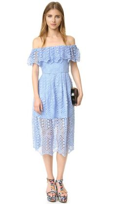 Modern lace over tonal lining composes this off-shoulder Cynthia Rowley midi-dress. A ruffle trims the covered-elastic neckline. Illusion hem.