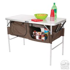 Store cooking supplies, plates, utensils and more in the fabric storage bins under the durable MDF table top.