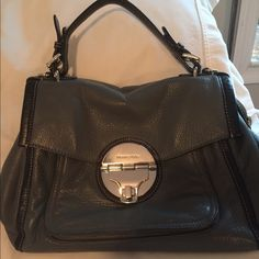 Minimal wear Michael Kors authentic bag This bag is a very thick leather! Grey and black! Have a lot of compartments! Inside has zipper and also small pockets... Under the latch is a small compartment and also in the back of the bag.. It has a small strap to use as a clutch and also long strap for Crossbody! No rips or stains! They dont make this bag anymore! It is a classic! Used maybe a handful if times! MICHAEL Michael Kors Bags