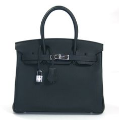 Hermès Blue Ocean Black Togo Leather 30 cm Birkin  - Pristine and never carried, this Hermès Blue Ocean Togo Leather 30 cm Birkin has been carefully stored with the protective felt. In fact, it still has the plastic intact on the hardware.     Considered the ultimate luxury item the world over and hand stitched by skilled craftsmen, wait lists for the Birkin often exceed a year or more.  This deepest shade of blue, known as Blue Ocean, appears black. It is like the darkest part of the ocean…