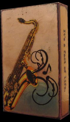 """RETIRED """"Sax"""" Spiritile by Houston Llew. Quote- """"Hipness isn't a state of mind, it's a fact of life!"""" - Cannonball Adderly. Features saxophone and hot jazz music!"""