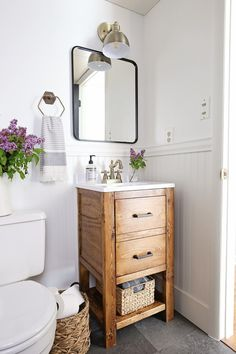 A small bathroom is made over into a classic, modern rustic bathroom on a budget! This small bathroom makeover used lots of budget-friendly DIY projects to transform a half bathroom! Bad Inspiration, Bathroom Inspiration, Bathroom Renos, Bathroom Storage, Bathroom Cabinets, Small Basement Bathroom, Simple Bathroom, Bathroom Organization, Small Bathroom Paint