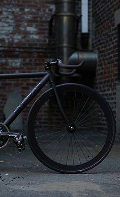 Matte black bike style. See more stylish women on bikes at  melisinestudio.com and d999f544f