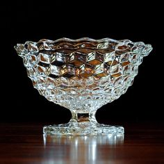 This piece is also known as the Footed Fruit Bowl and the Tom & Jerry Bowl.