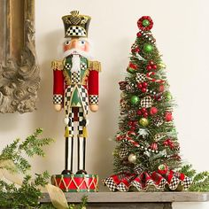 Highland Nutcracker | This spirited little soldier stands at attention in his holiday best. The Highland Nutcracker is a classic Christmas character decked out in touches of our signature Courtly Check®. He'd look at home on any mantel or placed into a holiday scene.