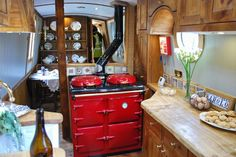 Houseboat.  Google Image Result for http://www.waterwaysworld.com/crick/Barolo_interior_0126_600.jpg