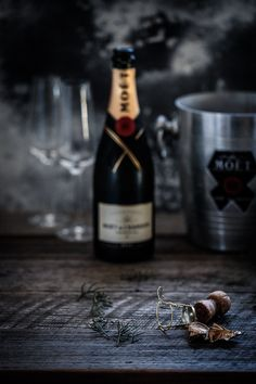 A simple champagne cocktail that's perfect to get any party started! Moët | Dark Food Photography | Moody | Chiaroscuro | Food Photography | Food Styling | Food Props | Anisa Sabet | The Macadames