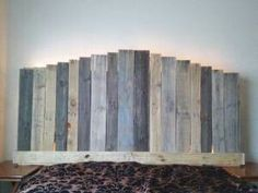 $475.   King size headboard made from recycled pallet wood with lights for ambiance. By Ramirez's Treasure's on Facebook.  '_'