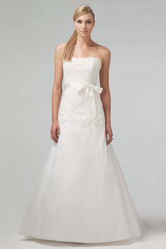Ivory lace strapless exaggerated drop waist bodice with flowing tulle skirt