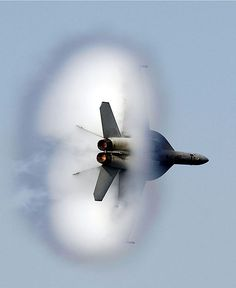 F-18 diamondback blast The sound is deafening. It hits your ears like a thunderclap or a shot. The noise fades and then everything is still as you look around to find the source. Suddenly you see something that shouldn't be there: the sight of a sonic boom.