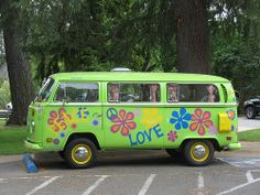 Hippie Vans ... I used to paint flowers on my car with liquid shoe polish during the sixties. Not as bright, but a dark car with white shoe polish worked just fine. #hippievans #lovevans www.OneMorePress.com