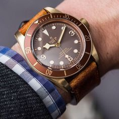 """The new """"Tudor Heritage Black Bay Bronze"""" looking clean on the wrist of @abtw_david The Heritage Black Bay Bronze features an imposing bronze case 43 mm in diameter. An aesthetic reference to the use of bronze in historic ships and diving equipment the choice of this metal  a high-performance aluminium bronze alloy with brushed finishes  lends a highly functional appearance to the watch and guarantees the development of a subtle and unique patina. #tudor #baselworld2016 #mt5601…"""