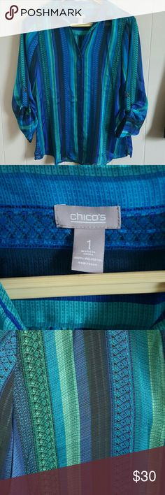 Beautiful Chico's (Size 1) Button Up Blouse Gorgeous blue and aqua Chico's button up. Size 1, equivalent to a M.  Excellent condition! Very lightweight and sheer. No rips, stains, tears or buttons missing. The colors in this top are stunning, pictures don't do it justice. Chico's Tops Blouses