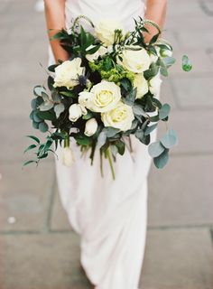 Ivory rose bouquet | Photography by http://www.davidjenkinsphotography.com/