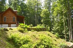 Log cabin in NC mountains - move-in ready. Only $249,900. Listed by Liz Riddick at Keller Williams High Country