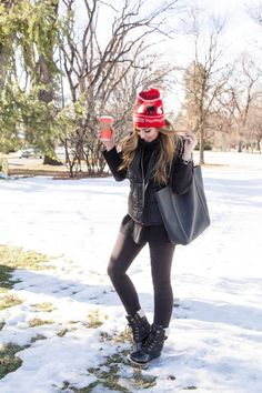 All black outfit with duck boots and red knitted stocking hat. How to look stylish in the winter... Keep things casual but classic. This OOTD on my website.