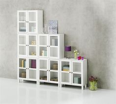 Layer sideboards and cabinets on top of each other for an original storage solution. White lounge and hallway furniture at its best from JYSK. Hallway Furniture, Home Furniture, Furniture Ideas, White Lounge, Sideboard Cabinet, Scandinavian Living, Glass Door, Small Spaces, Bookcase