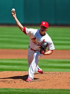 Starting picther Shelby Miller throws to a Cincinnati Reds batter during the second inning. Cards lost 4-0. 4-09-14