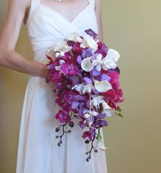 This bouquet has been made with 24 real touch mini calla lilies. Each calla lily head is Total length of bouquet from top to bottom is Handle is wrapped in a white satin ribbon & rhinestone accented. Orchid Bridal Bouquets, Calla Lily Bouquet, Cascade Bouquet, Wedding Bouquets, Purple Orchid Bouquet, Rose Bouquet, Purple Calla Lilies, Purple Orchids, White Orchids