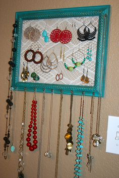 Jewelry hanger  - painted cheap frame, old pair of of lace tights, eye-hooks for necklaces. Practical and pretty!