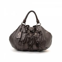 LXRandCo guarantees this is an authentic vintage Prada Ruffle shoulder bag  shoulder bag. This sophisticated purse was crafted in napa leather leather  in ... 5ab98835f1dc2