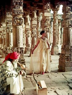 Barbara Mullen in evening gown by Christian Dior, photo by Norman Parkinson, The pillars of Quwat-Ul-Islam Mosque, Dehli, India, Vogue 1956