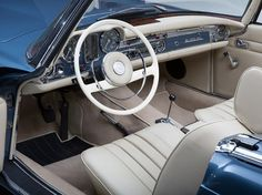 MERCEDES-BENZ 230 SL, Pagoda, Model 1966. As calm as this cream leather interior looks with the blue metallic, it is sadly from 2012. The original interior was a vibrant red. https://djciyp3li67lh.cloudfront.net/1670/70561/36198971_9_l.jpg