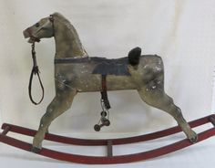 Child's rocking horse in original paint and saddle