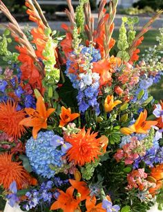 orange and blue wedding flowers; nice contrast, using opposites from the color wheel.