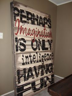 "Re-using things to make beautiful art and furniture.  (Wait.  Just realized they misspelled ""intelligence.""  Right?  Or am I just tired and forgetting out to spell?  Oh, well...still LOVE this idea, the size of it.)  :)"