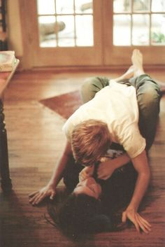 love the playful wrestling match full of giggles that ends with you trapped in his arms, your eyes locked, and the kiss you know is inevitable.