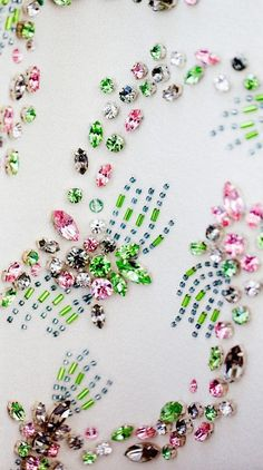A backstage look at the bejeweled fabrics at Giambattista Valli Couture