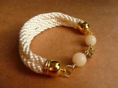 Nice Kumihimo bracelet, using white Rat Tail. I like the look of using several strands, in leu of just one.