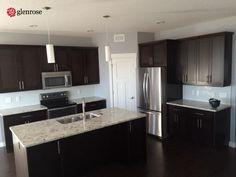 kitchen with granite countertops, tile backsplash, walk through pantry. 4502 Delhaye Way, in Harbour Landing