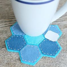 Felt and hexagons come together to create an artistic coaster.  Full tutorial.